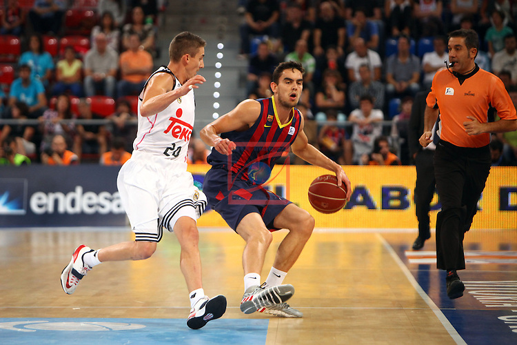 XI Supercopa ENDESA-Final.<br /> R. Madrid vs FC Barcelona: 99-78.<br /> Jaycee Carroll vs Satoransky.