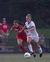 Boston College midfielder Kristen Mewis (19) brings the ball forward as Boston University defender Kai Miller (19) defends. After 2 complete overtime periods, Boston College tied Boston University, 1-1, after 2 overtime periods at Newton Soccer Field, August 19, 2011.