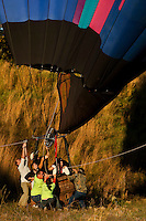 A team works to steady a balloon during the annual Carolina BalloonFest, held each fall in Statesville, NC. Photos were taken at the October 2008 event.