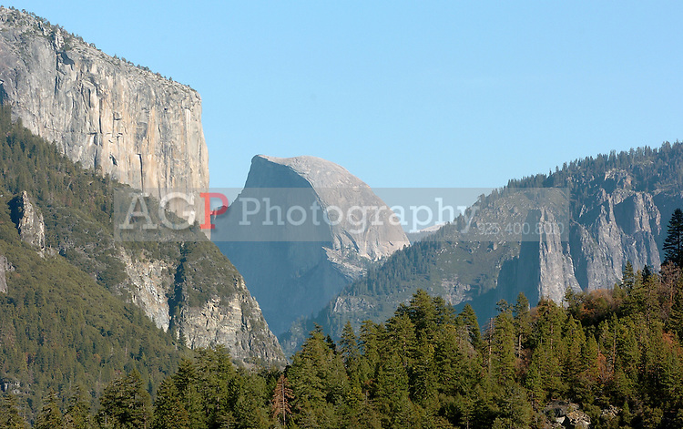 This view of El Capitan, left, and Half Dome is your first glimpse of the famous landmarks upon entering Yosemite from the North Gate. This image was made National Park in California November 22, 2008. (Photo Copyright Alan Greth)
