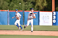 Kingsport Mets third baseman Eudor Garcia #44 throws to first as Luis Guillorme #13 backs up the play during a game against the Johnson City Cardinals at Hunter Wright Stadium August 24, 2014 in Kingsport, Tennessee. The Mets defeated the Cardinals 9-1. (Tony Farlow/Four Seam Images)