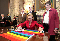Washington State Govenor Christine Gregoire prepares to sign a Rainbow flag after signing the gay-marriage bill into law on February 13, 2012. She was asked to sign the flag by Nake Stevens of Olympia, Wa., right. The historic law takes effect June 7th, though opponents have vowed to overturn it with a ballot measure. Meryl Schenker Photography