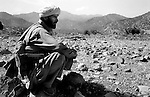 barwaiz raghzai hills, south waziristan, pakistan april 2004: deep in mountains of south waziristan, bordering afghanistan, a tribeman keep a look out.  the tribesmen have been finding and destroying homes they suspect were being used for giving shelter to al qaeda fighters.  lookouts are left behind after a house has been destroyed to make sure the inhabitants do not return<br />