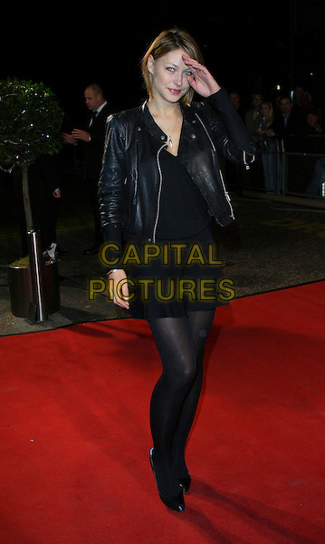 "EMMA GRIFFITHS.Celebrity Guests attend ""Another Audience with Al Murray - Pub Landlord"" at London ITV Studios, South Bank, London, England, October 21st 2007..full length black leather jacket hand touching head.CAP/ROS.©Steve Ross/Capital Pictures"