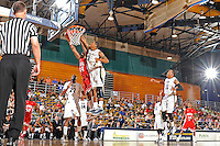 28 January 2012:  FIU guard-forward Dominique Ferguson (3) blocks a shot by WKU guard-forward George Fant (44) in the first half as the Western Kentucky University Hilltoppers defeated the FIU Golden Panthers, 61-51, at the U.S. Century Bank Arena in Miami, Florida.