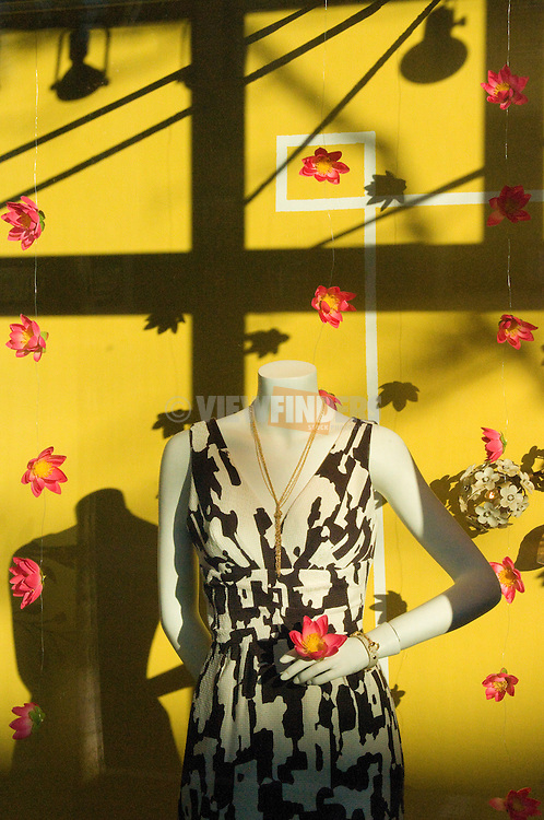 Store Window Display with Mannequin and Flowers