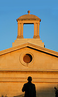 Low angle view of the facade of the Garrison Chapel, 19th century, Valletta, Malta, pictured on June 6, 2008, in the afternoon with a staue silhouetted in the foreground. The Republic of Malta consists of seven islands in the Mediterranean Sea of which Malta, Gozo and Comino have been inhabited since c.5,200 BC. It has been ruled by Phoenicians (Malat is Punic for safe haven), Greeks, Romans, Fatimids, Sicilians, Knights of St John, French and the British, from whom it became independent in 1964. Nine of Malta's important historical monuments are UNESCO World Heritage Sites, including  the capital city, Valletta, also known as the Fortress City. Built in the late 16th century and mainly Baroque in style it is named after its founder Jean Parisot de Valette (c.1494-1568), Grand Master of the Order of St John. The British Garrison Chapel was converted into the Malta Stock Exchange in 2001. Picture by Manuel Cohen.