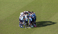 Wycombe Wanderers players during the pre match team huddle during the Sky Bet League 2 match between Wycombe Wanderers and Mansfield Town at Adams Park, High Wycombe, England on 25 March 2016. Photo by Andy Rowland.
