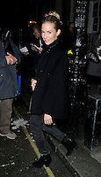 """SIENNA MILLER .Departed after the first preview performance of """"Flare Path"""", Haymarket, London, England, UK, 4th March 2011..full length black coat cape grey gray jeans denim side smiling .CAP/CAN.©Can Nguyen/Capital Pictures."""