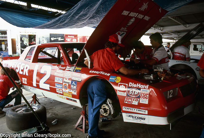 Crewmen work on the #12 Chevriolet Monte Carlo of driver Neil Bonnett in preparation for the Southern 500 at Darlington Raceway in Darlington SC on September 1, 1985. (Photo by Brian Cleary/www.bcpix.com)