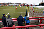 Altrincham 2 Worcester City 0, 23/03/2013. Moss Lane, Blue Square Bet North. The four travelling fans watching the action during the second-half of the the Blue Square Bet North fixture between Altrincham (in red) and Worcester City at Moss Lane, Altrincham. The home team won the match 2-0 watched by 777 spectators on a day when most non-League football in England was cancelled due to adverse weather. Altrincham were historically one of the major English non-League teams but have never been promoted to the Football League. Photo by Colin McPherson.