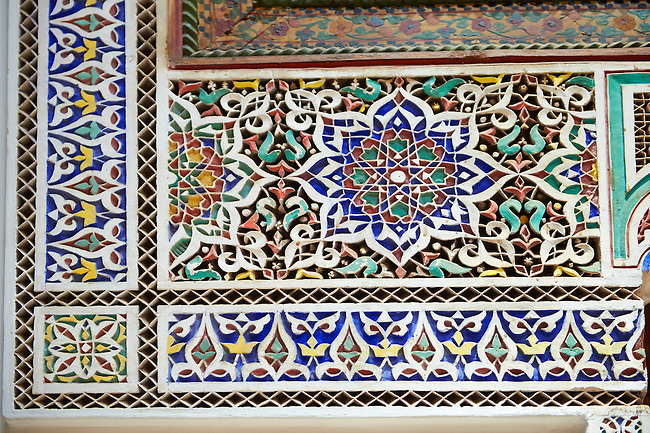 Berber Arabesque painted mocarabe plasterwork  of the Marrakesh museum in the Dar Menebhi Palace, Marrakesh, Morocco
