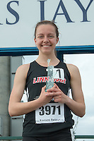 Stephanie Jenks holds her Statue of Liberty trophy after winning the 1600-meters at the 2015 Kansas Relays and earning a berth in the high school Dream Mile race at the 2015 Adidas Grand Prix track meet in New York City in June.