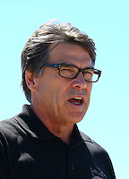 Sept. 21, 2013; Ennis, TX, USA: NHRA Texas governor Rick Perry during the Fall Nationals at the Texas Motorplex. Mandatory Credit: Mark J. Rebilas-