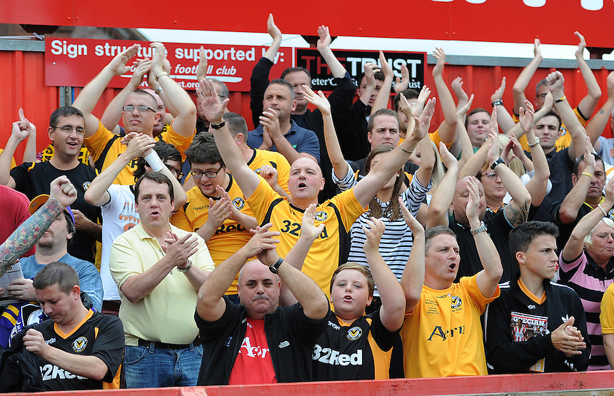Newport County fans during the game <br /> <br /> Photo by Ashley Crowden/CameraSport<br /> <br /> Football - The Football League Sky Bet League Two - Exeter City v Newport County - Saturday 21st September 2013 - St James Park - Exeter<br /> <br /> &copy; CameraSport - 43 Linden Ave. Countesthorpe. Leicester. England. LE8 5PG - Tel: +44 (0) 116 277 4147 - admin@camerasport.com - www.camerasport.com