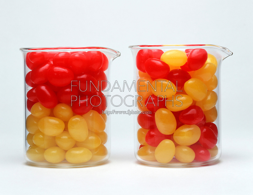 ENTROPY: ILLUSTRATION<br /> (Variations Available)<br /> Arrangement of Jellybeans in 2 Beakers.<br /> Two beakers contain red & yellow beads.  Because entropy can be viewed as a measure of disorder, the arrangement in which the colors are separated represents a system of lower entropy than the one in which the colors are mixed.