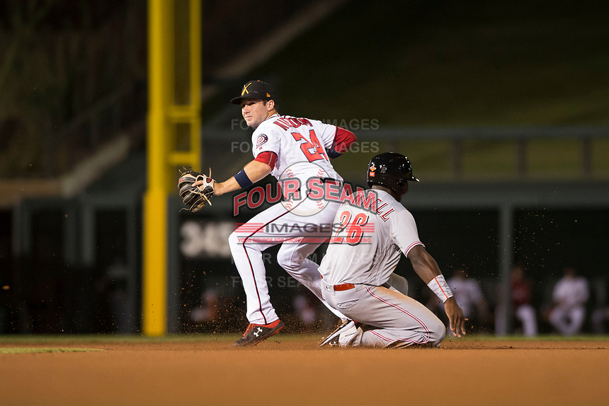 Salt River Rafters second baseman Carter Kieboom (24), of the Washington Nationals organization, throws to first base to try to complete a double play as Taylor Trammell (26) slides into second base during an Arizona Fall League game against the Scottsdale Scorpions at Salt River Fields at Talking Stick on October 11, 2018 in Scottsdale, Arizona. Salt River defeated Scottsdale 7-6. (Zachary Lucy/Four Seam Images)