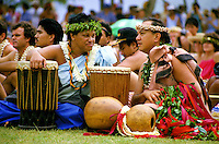 Historic photo of a younger Robert Cazimero and Leinaala Heine as they wait to performance at a hula festival on Oahu.