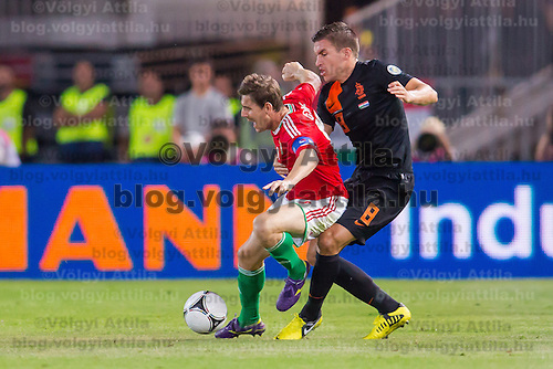Hungary's Zoltan Gera (L) and Netherlands' Kevin Strootman (R) fight for the ball during a World Cup 2014 qualifying soccer match Hungary playing against Netherlands in Budapest, Hungary on September 11, 2012. ATTILA VOLGYI