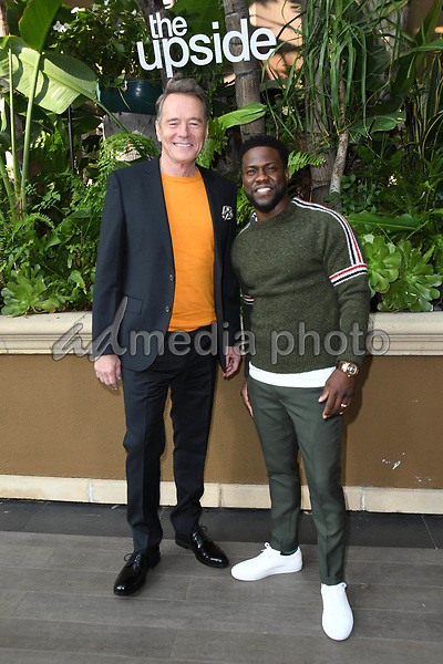 "30 October 2018 - Beverly Hills, California - Bryan Cranston, Kevin Hart. ""The Upside"" Photo Call held at The Four Seasons at Beverly Hills . Photo Credit: Birdie Thompson/AdMedia"