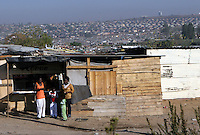 Squatter villages run for miles outside the sprawling city of Johannesburg, South Africa. Photo by Matt May