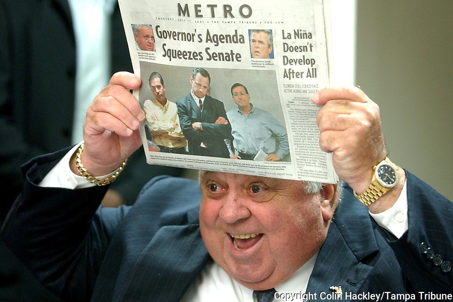 TALLAHASSEE, FL. 7/17/03-During a light moment Senate President Jim King, R-Jacksonville, pokes fun at his negotiation team pictured on the Metro Section of Thursday's Tampa Tribune during a news conference Thursday at the Capitol in Tallahassee. King spent the rest of the news conference describing the latest version of the Senate's medical malpractice insurance bill..COLIN HACKLEY PHOTO