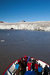 Tourists on board the Polargirl expedition ship at Esmark Glacier in Isfjorden, Svalbard.