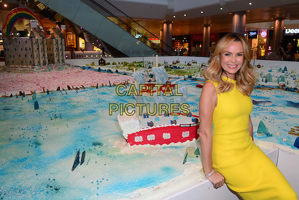 Amanda Holden cuts the first slice of Fairy's attempt at the World's Largest Cake Sculpture in aid of the Make A Wish foundation's Bake A Wish initiative on 28 November 2014. 12,000 slices of cake are expected to be eaten at Westfield London, England.  <br /> CAP/JOR<br /> &copy;Nils Jorgensen/Capital Pictures