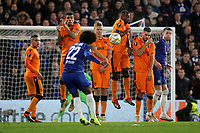 A free-kick from Chelsea's Willian is blocked by the PAOK Salonika defensive wall during Chelsea vs PAOK Salonika, UEFA Europa League Football at Stamford Bridge on 29th November 2018
