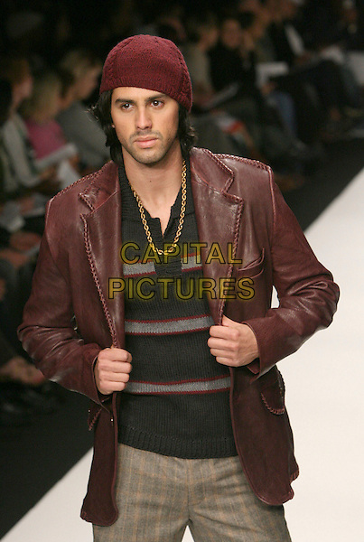 MODEL.Mercedes-Benz Fall 2006 L.A. Fashion Week - Anthony Franco held at Smashbox Studios, Culver City, California, USA..March 22nd, 2006.Photo: Zach Lipp/AdMedia/Capital Pictures.Ref: ZL/ADM.catwalk runway half length brown leather jacket hat burgundy.www.capitalpictures.com .sales@capitalpictures.com.© Capital Pictures.