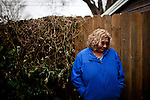Liz Fenimore poses for a portrait at her daughter's home, where she sleeps on the couch in Sacramento, Calif. January 17, 2011.