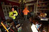 NWA Democrat-Gazette/ANDY SHUPE<br /> Valerie Wright (left) and her husband, Timothy Wright, put on dust masks Saturday, Jan. 6, 2018, before continuing to clean up inside their entry room after a fire heavily damaged their 1930s-era home Christmas Eve in Cincinnati. Valerie Wright kept a blog to chronicle the progress of the renovations of the historic home that they have been working on for about seven years.
