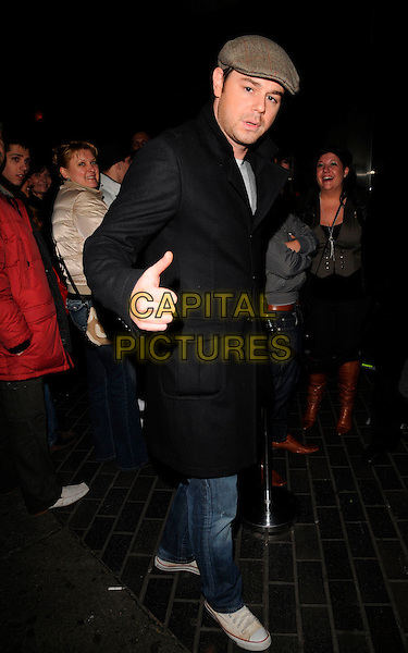 DANNY DYER .Spotted outside the Isis Club, London,.England, February 22nd 2008..full length thumb up fat cap hat black coat.CAP/CAN.?Can Nguyen/Capital Pictures
