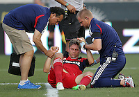 CHESTER, PA - AUGUST 12, 2012:   Logan Pause (12) of the Chicago Fire is helped up after being injured, shortly after, he left the field with concussion symptoms during an MLS match against the Philadelphia Union at PPL Park, in Chester, PA on August 12. Fire won 3-1.