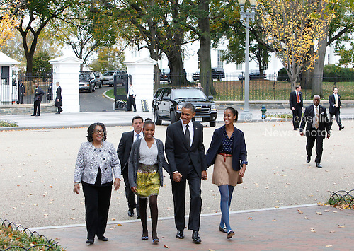 United States President Barack Obama walks to St. John's Episcopal Church with his daughters on Sunday, October 28, 2012. From left to right:  Kaye Wilson,Godmother to Malia and Sasha,   Sasha Obama, President Obama, Malia Obama..Credit: Dennis Brack / Pool via CNP