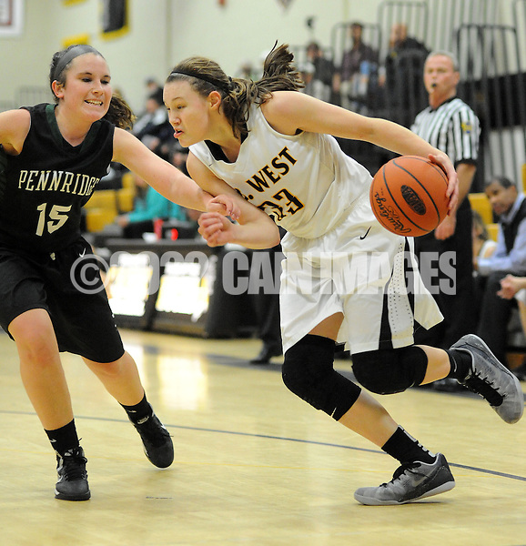 DOYLESTOWN, PA - DECEMBER 16: Central Bucks West's Nicole Munger #33 drives towards the basket as Pennridge's Jenna Dominic defends in the third quarter of a game at Central Bucks West December 16, 2014 in Doylestown, Pennsylvania. (Photo by William Thomas Cain/Cain Images)
