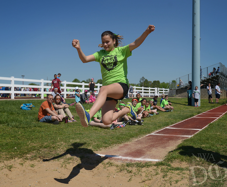 NWA Democrat-Gazette/BEN GOFF @NWABENGOFF<br /> Fifth graders compete in the girls' long jump on Saturday April 23, 2016 during the 41st Annual Springdale Kiwanis Little Olympics at the Roberts Track Complex at Southwest Junior High School in Springdale. Over 800 5th graders from Springdale schools competed in 10 track and field events.
