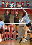 SIOUX FALLS, SD - SEPTEMBER 16: Caryn Hazard #4 and Jamie Kayl #13 from Washington attempt to block a kill by Maddi Barness #4 from Lincoln in the first game of their match Tuesday night at Lincoln.  (Photo by Dave Eggen/Inertia)