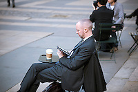 A man reads on his Amazon Kindle in Bryant Park in New York on Thursday, February 23, 2012. (© Richard B. Levine)