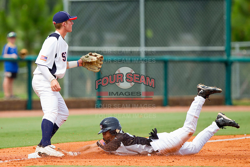 Shane Brown #21 of RBI slides head first into third base with a triple as Max Dutto #13 of STARS waits for the throw at the 2011 Tournament of Stars at the USA Baseball National Training Center on June 26, 2011 in Cary, North Carolina. (Brian Westerholt/Four Seam Images)