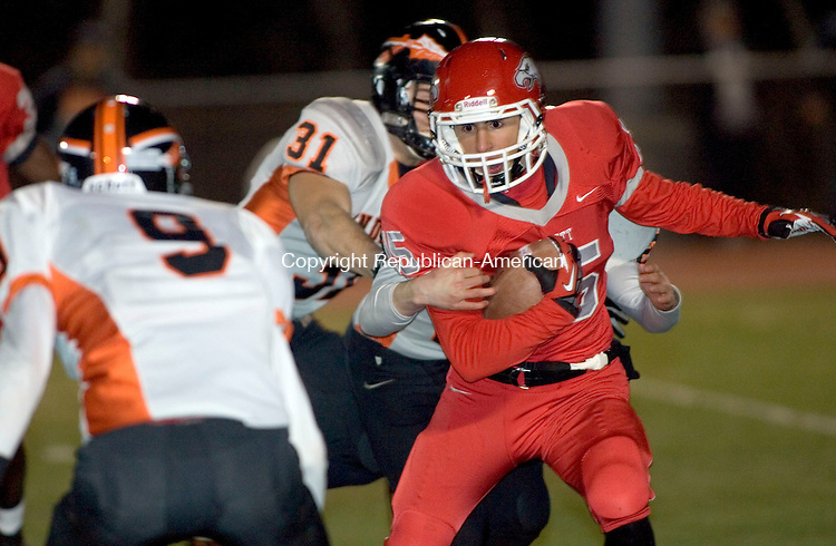 WOLCOTT, CT. 28 November 2012-112812SV06-#15 Vincent Gambino of Wolcott tries to turn the corner during second quarter CIAC Class M action against Montville in Wolcott Wednesday..Steven Valenti Republican-American