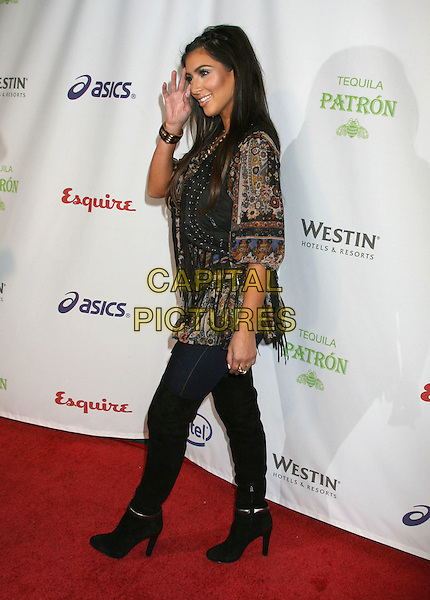 "KIM KARDASHIAN .Esquire House Hollywood Hills ""Rock The Vote"" Hosted by Christina Aguilera held at The Esquire House, Los Angeles, California, USA, .25 September 2008..full length print fringe tassels fringed waistcoat vest brown braids plaits print top blouse jeans over the knee high boots .CAP/ADM/MJ.©Michael Jade/Admedia/Capital Pictures"