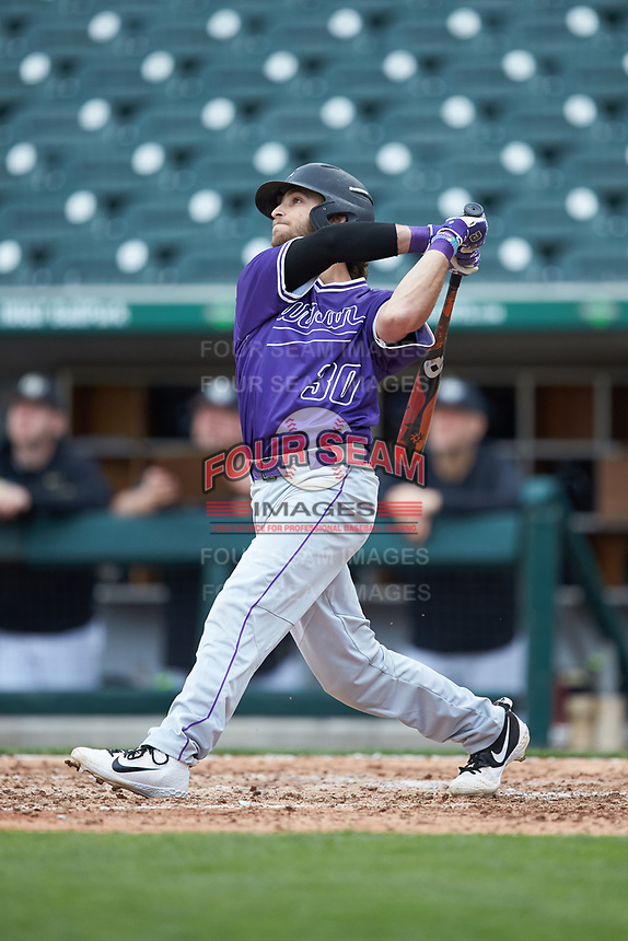 Logan Kellerman (30) of the Furman Paladins follows through on his swing against the Wake Forest Demon Deacons at BB&T BallPark on March 2, 2019 in Charlotte, North Carolina. The Demon Deacons defeated the Paladins 13-7. (Brian Westerholt/Four Seam Images)