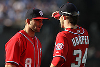 Danny Espinosa #8 of the Washington Nationals talks with teammate Bryce Harper #34 before a game against the Los Angeles Dodgers at Dodger Stadium on April 28, 2012 in Los Angeles,California. Los Angeles defeated Washington 4-3.(Larry Goren/Four Seam Images)