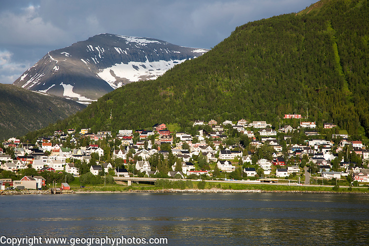 Suburban housing and landscape of snow on mountain side, Tromso, Norway