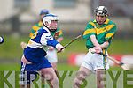 St Brendans forward Tim Hanafin tries to block Kilmoyley corner back Jason Fealeys clearance in their County U/21 Final in Austin Stack Park on Saturday..