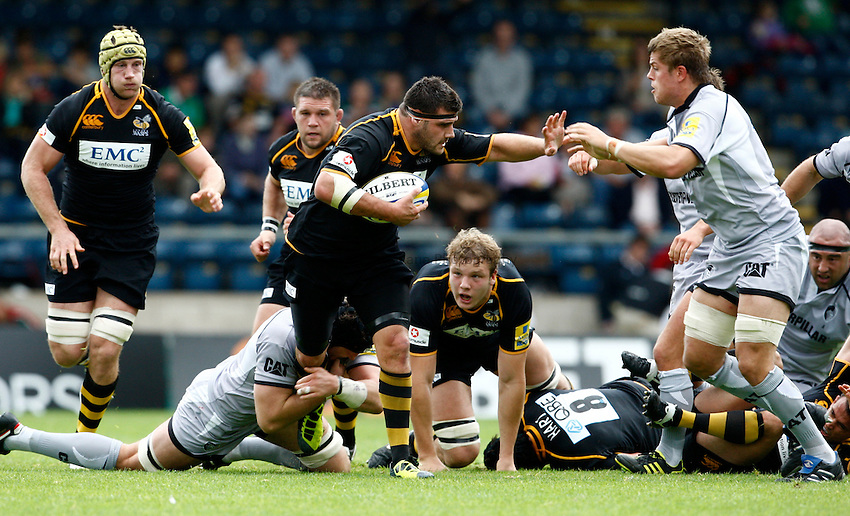 Photo: Richard Lane/Richard Lane Photography. London Wasps v Leicester Tigers. 11/09/2011. Wasps' Rob Webber is tackled by Tigers' George Skivington.