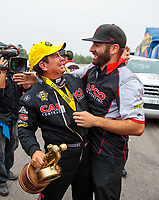 Aug 19, 2018; Brainerd, MN, USA; NHRA top fuel driver Billy Torrence celebrates with crew member Dom Lagana after winning the Lucas Oil Nationals at Brainerd International Raceway. Mandatory Credit: Mark J. Rebilas-USA TODAY Sports