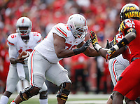 Ohio State Buckeyes offensive lineman Darryl Baldwin (76) blocks for quarterback Cardale Jones (12) during the Buckeyes' 52-24 win over the Maryland Terrapins in the NCAA football game at Byrd Stadium in College Park, Maryland on Oct. 4, 2014. (Adam Cairns / The Columbus Dispatch)