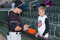 Tyler Sullivan (2) of the Kannapolis Intimidators signs a cap for a young fan prior to the game against the Asheville Tourists at Kannapolis Intimidators Stadium on May 6, 2017 in Kannapolis, North Carolina.  The Intimidators walked-off the Tourists 7-6.  (Brian Westerholt/Four Seam Images)